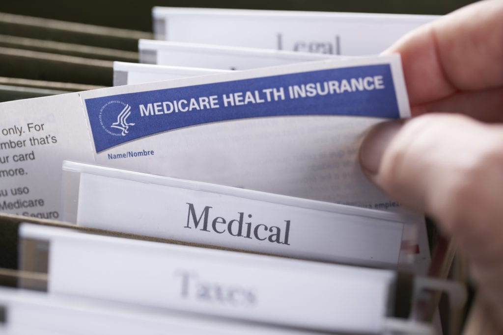 Medicare Health Insurance Card in file folder
